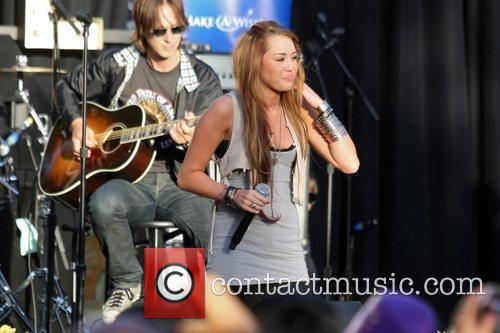 Miley Cyrus performs at the Grove Los Angeles,...