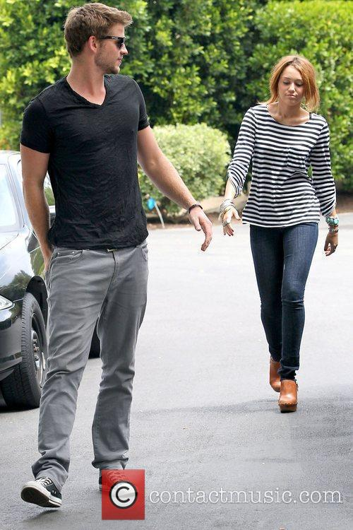 Liam Hemsworth and Miley Cyrus Miley Cyrus out...