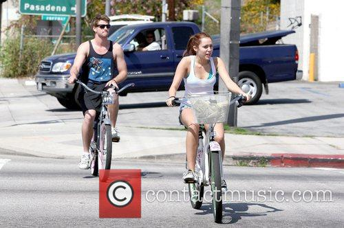Liam Hemsworth and Miley Cyrus Miley Cyrus rides...