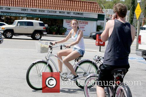 Miley Cyrus and Liam Hemsworth Miley Cyrus rides...