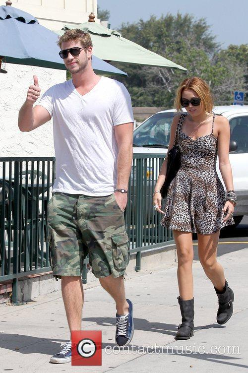 Liam Hemsworth and Miley Cyrus arriving for breakfast...