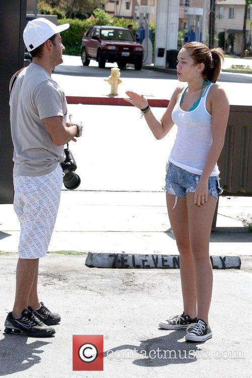 Miley Cyrus gets upset with a photographer and...