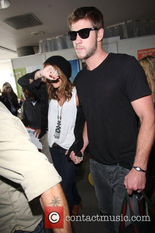 Miley Cyrus and Liam Hemsworth 24