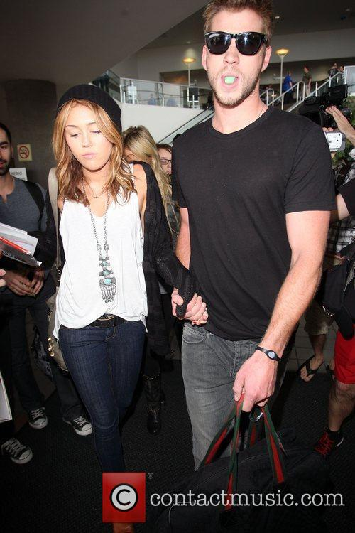 Miley Cyrus and Liam Hemsworth 23