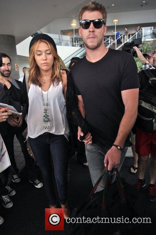 Miley Cyrus and Liam Hemsworth 35