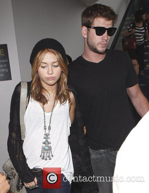 Miley Cyrus and Liam Hemsworth 40