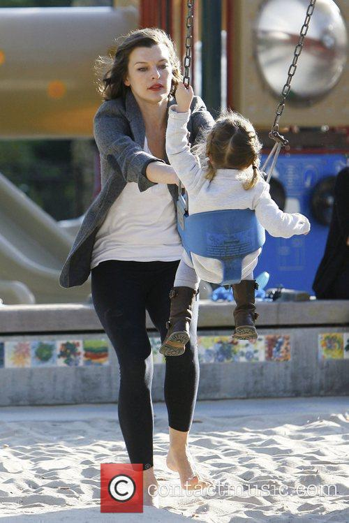Milla Jovovich playing at Coldwater Canyon Park in...