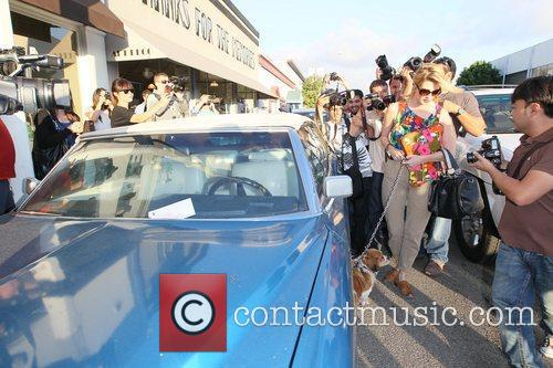 Mischa Barton  is surrounded by photographers as...