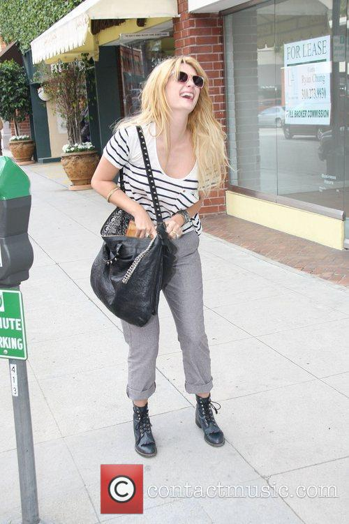 Mischa Barton pays a parking meter before going...