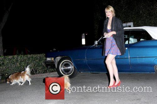Mischa Barton next to her 1970 Cadillac convertible...