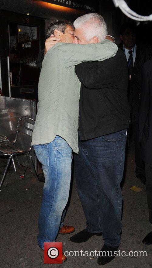 Mitch Winehouse hugs a friend as he leaves...