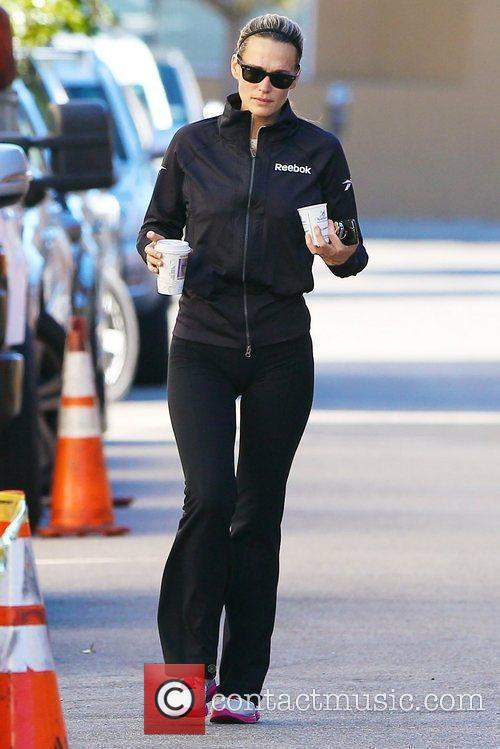Molly Sims  picks up coffee after leaving...