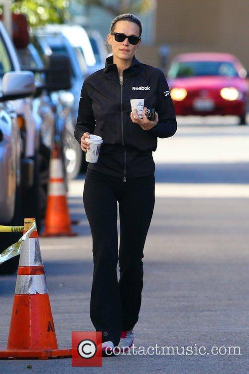 Picks up coffee after leaving her gym in...