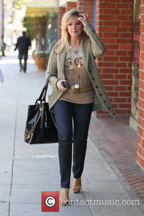Morgan Fairchild walking in Beverly Hills wearing a...