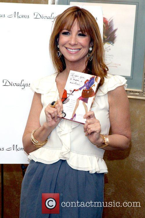 Jill Zarin holding a book presented to her...
