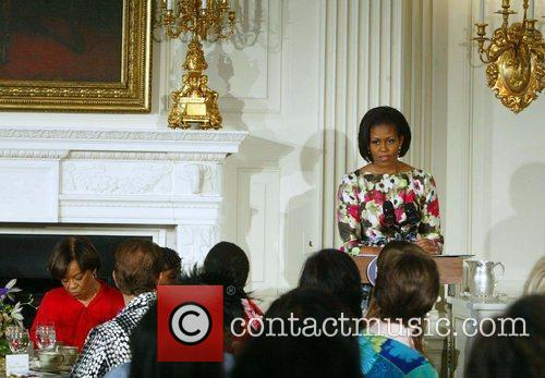 First Lady Michelle Obama holds a Mother's Day...