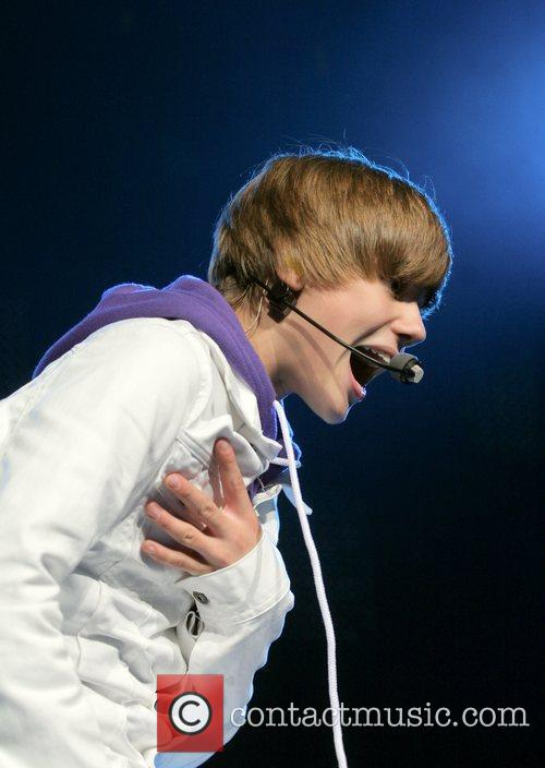 Performs during the 'My World' tour at the...
