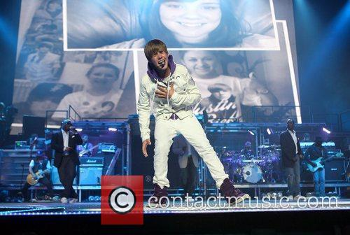 Singer Justin Bieber  performs on stage with...