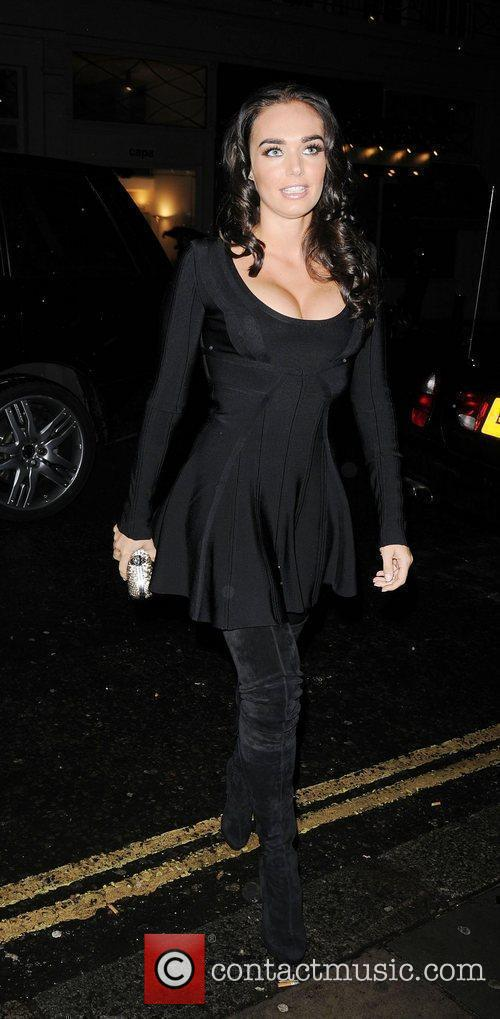 Tamara Ecclestone in thigh length boots and a...