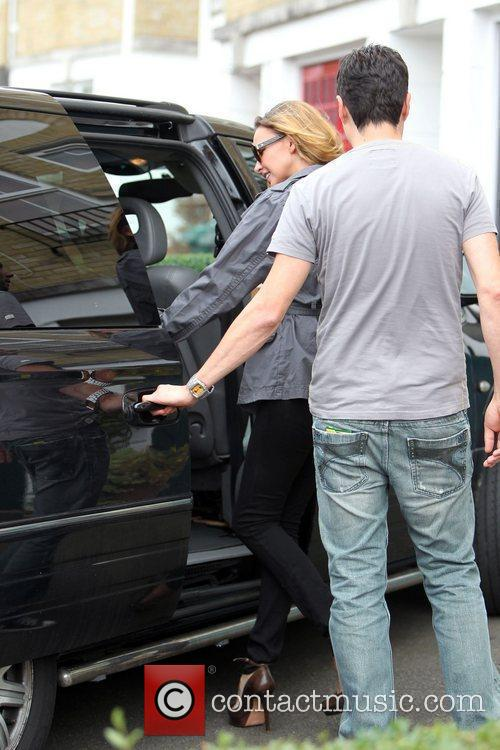 Nadine Coyle is all smiles as she leaves...