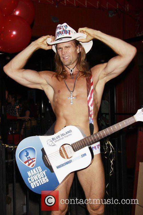 Robert John Burck aka The Naked Cowboy 15