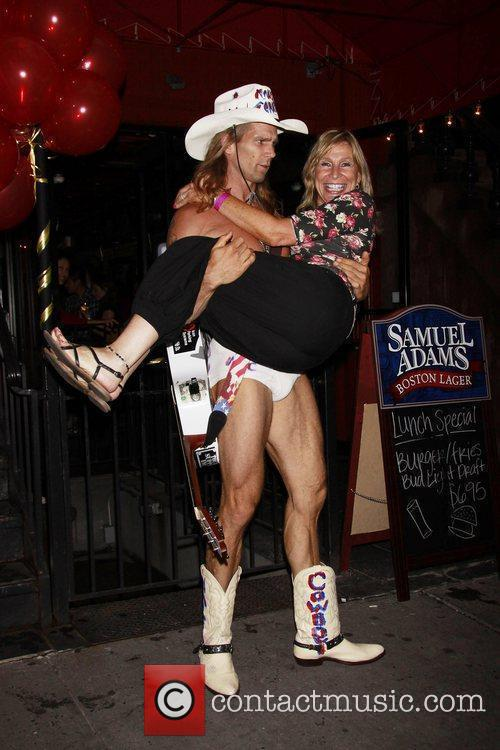 Robert John Burck aka The Naked Cowboy 17