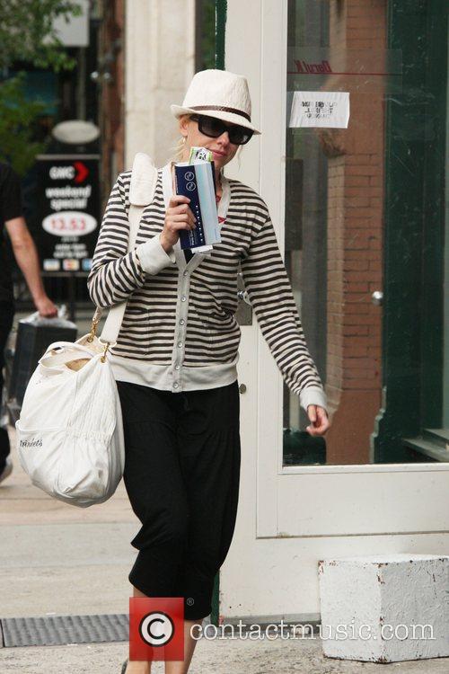 Naomi Watts returns to her New York home...