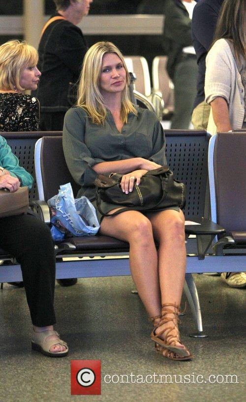 Natasha Henstridge waits for a passenger to arrive...