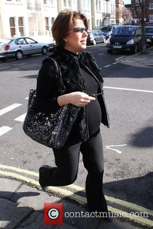 A heavily pregnant Natasha Kaplinsky leaving her house...