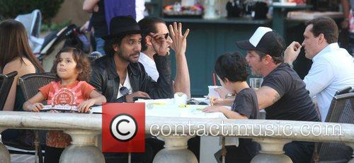 Naveen Andrews enjoys lunch with his friend and...