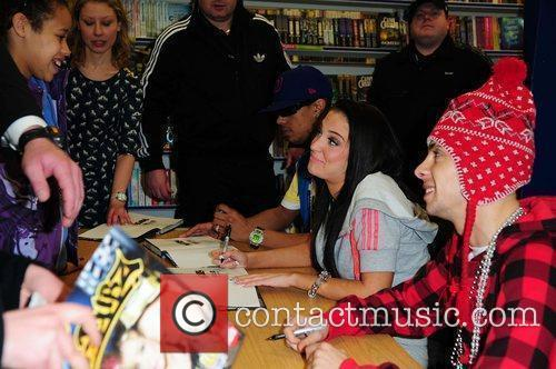 N-Dubz sign copies of their book 'N-Dubz: Against...
