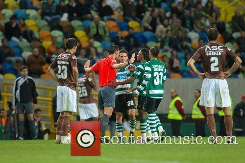 Pedro Proenca, referee, calls attention to Sporting players...