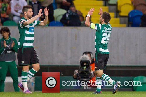 Joao Moutinho from Sporting celebrates goal with Miguel...
