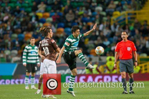 Helder Postiga from Sporting vies the ball with...