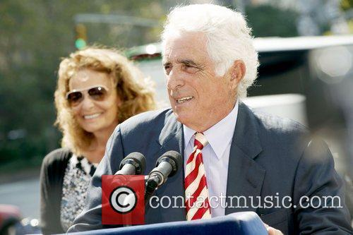 Ted Forstmann speaks at a press conference as...