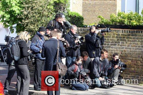 Press wait outside Nick Clegg's house awaiting his...