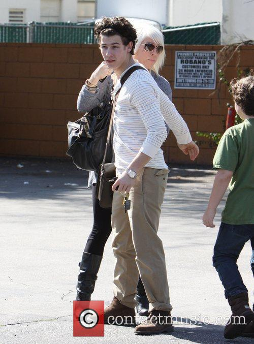 Nick Jonas and female companion out and about...