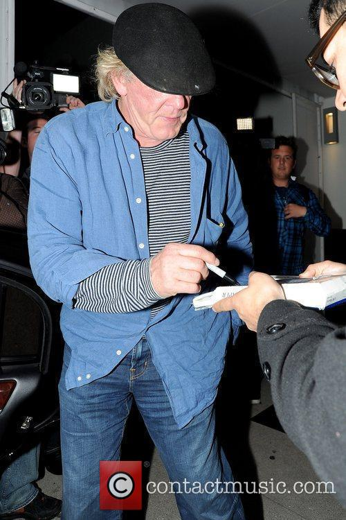 Nick Nolte signing an autograph while leaving Philippe...