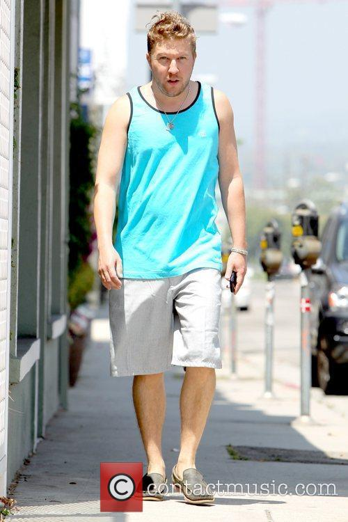 Actor and comedian walking down Melrose Avenue wearing...