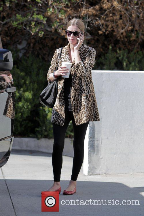 Nicky Hilton  waits for the valet to...