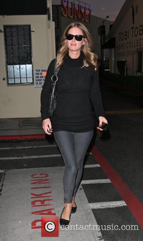 Nicky Hilton leaves from the back door of...