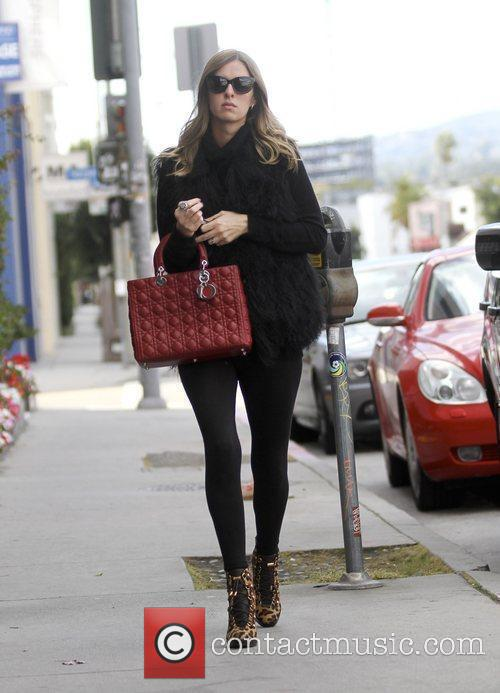 Is seen out and about toting a Dior...