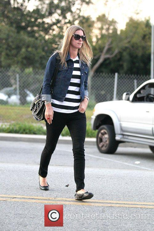 A stylish looking Nicky Hilton wearing a black...