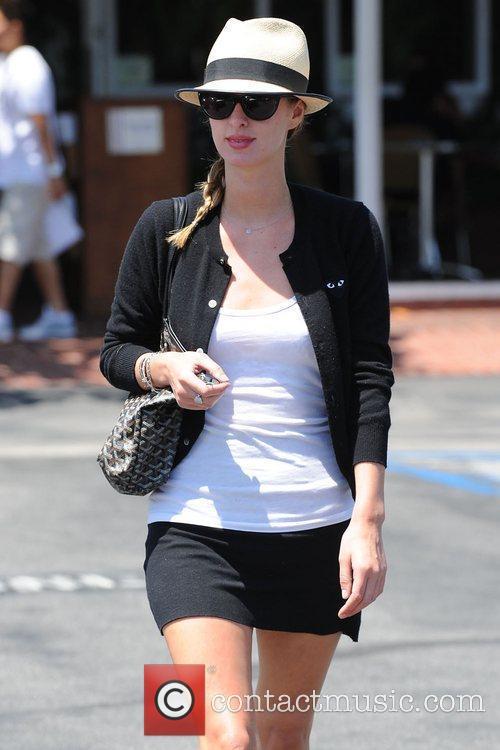 Nicky Hilton, wearing a straw fedora, seen outside...