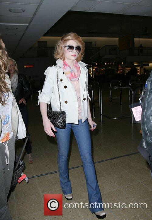 Nicola Roberts arriving at Heathrow after flying in...