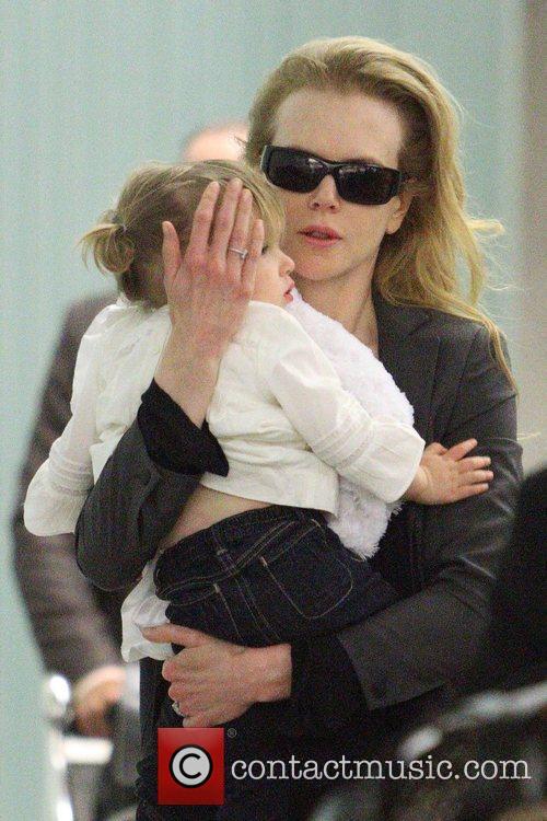 Nicole Kidman carries her daughter, Sunday Rose, as...