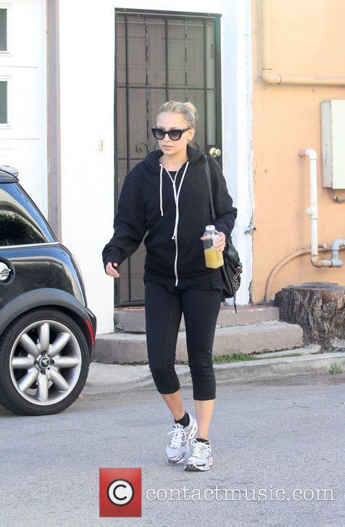 Nicole Richie in black sportswear and wearing oversized...