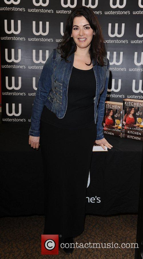 Nigella Lawson signs copies of her book 'Kitchen'...