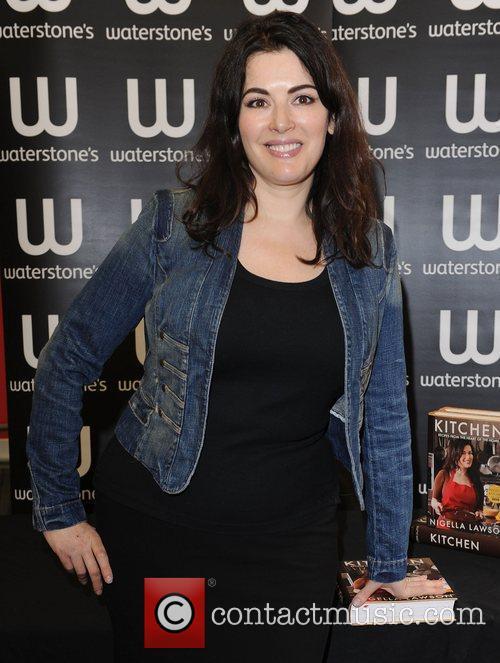 Signs copies of her book 'Kitchen' Waterstone's Kensington