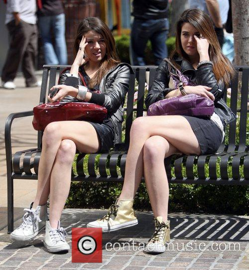 Nikita and Jade Ramsey  sitting on a...